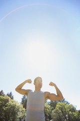 Man flexing biceps outdoors