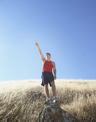 Male athlete gesturing in the countryside