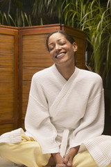 Woman in spa robe smiling