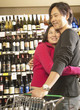 Asian couple hugging in grocery store