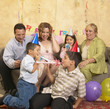 Hispanic family at birthday party