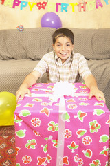 Hispanic boy with large gift
