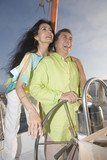 Couple enjoying a sailboat cruise