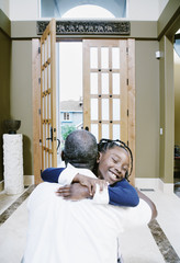 Girl hugging man at home