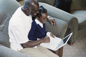 Man and girl with laptop computer