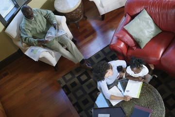 Family reading in home