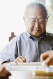 Elderly man playing game