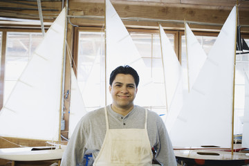 Portrait of man with model sailboats