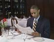 Businessman reading newspaper at restaurant