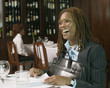 Businesswoman laughing at table in restaurant