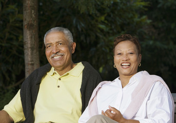 Senior couple sitting and smiling