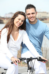 a couple doing bike