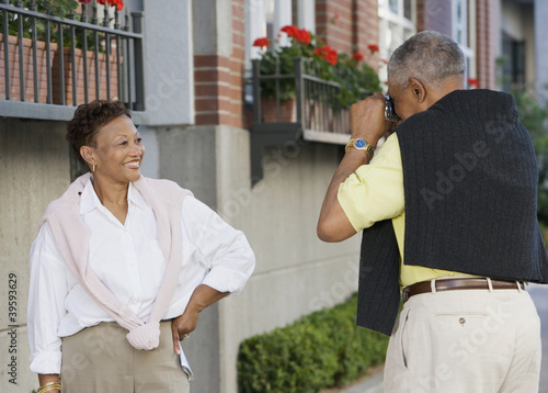 Woman posing for man taking picture