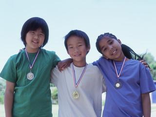 Group portrait of children wearing metals