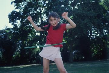 Portrait of girl playing with hoola hoop