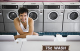 Portrait of man in tank top at laundromat