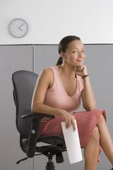Portrait of businesswoman sitting in office