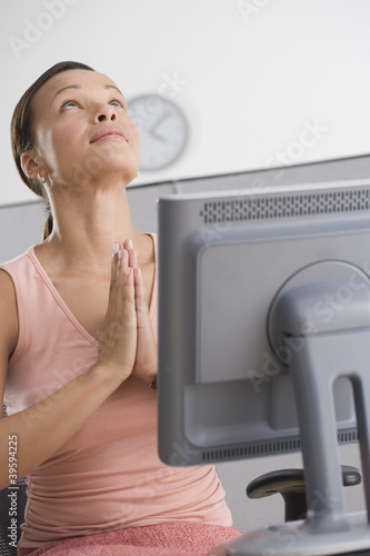 Woman praying in office