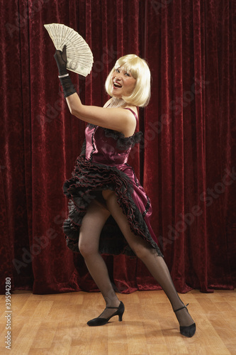 Portrait of woman with showgirl dress and fan