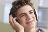 Close up of teenage boy with headset smiling