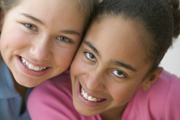 Close up portrait of two girls smiling