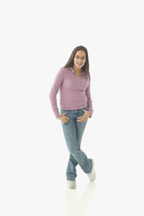 Portrait of teenage girl standing with legs crossed
