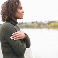 Profile of woman standing by lake