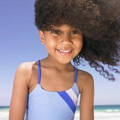 Girl smiling at beach