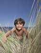Portrait of boy in beach grass
