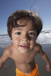 Portrait of boy looking into camera at beach