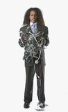 Full view portrait of businessman holding tangled computer cords