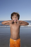 Portrait of boy making face at beach