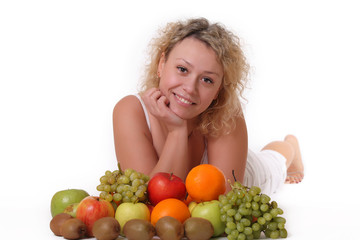 portrait of a smiling woman with fruits
