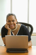 African American businesswoman sitting with laptop