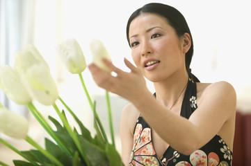 Woman arranging tulips