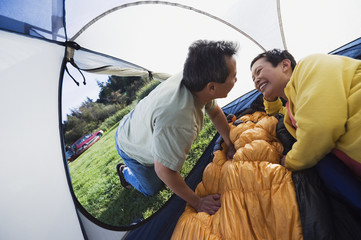 Couple kissing in tent