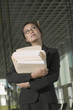 Businesswoman holding stack of paperwork