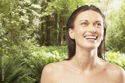 Portrait of woman smiling in forest
