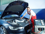 Motor mechanic working on engine bay with air handling unit