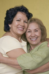 Portrait of two woman hugging
