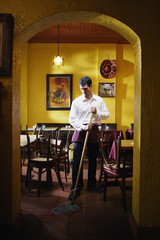 Man mopping restaurant floor