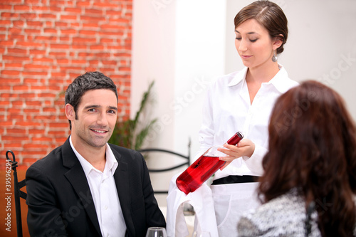 Sommelier presenting a wine to a restaurant patron