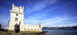 panoramic view of Tower of Belem with blue sky, Lisbon