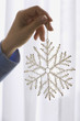 Woman holding a snowflake decoration