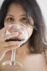 Young woman drinking a glass of wine