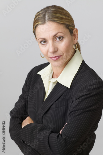Middle aged businesswoman posing for the camera with arms crossed