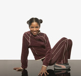 Young woman posing for the camera in a track suit