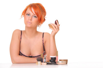 beautiful young girl with cosmetics , lipstick
