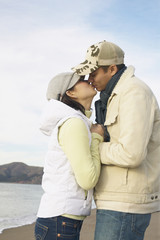 Young couple kissing on the beach