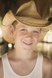 Young boy wearing a cowboy hat
